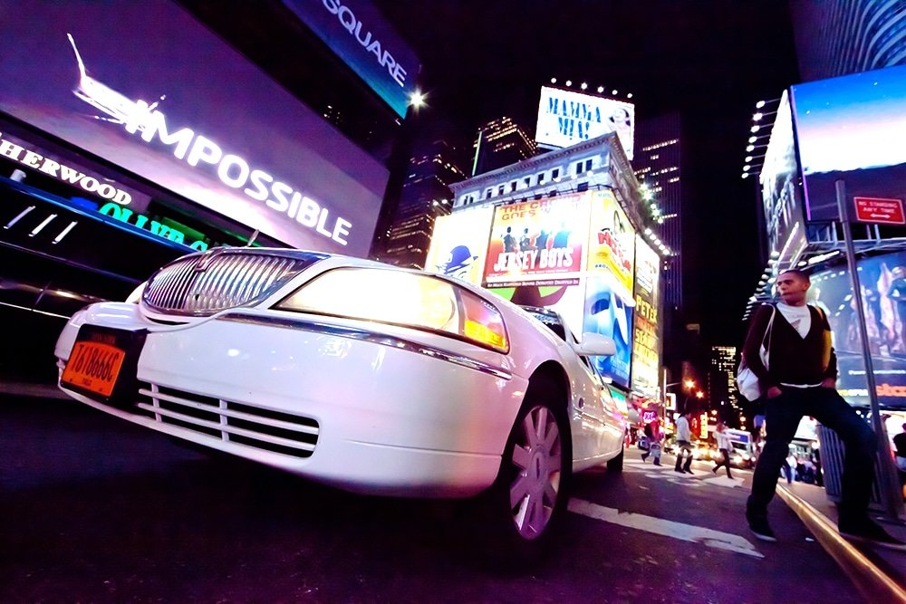 Limousine Barcelona services a white limo with clients