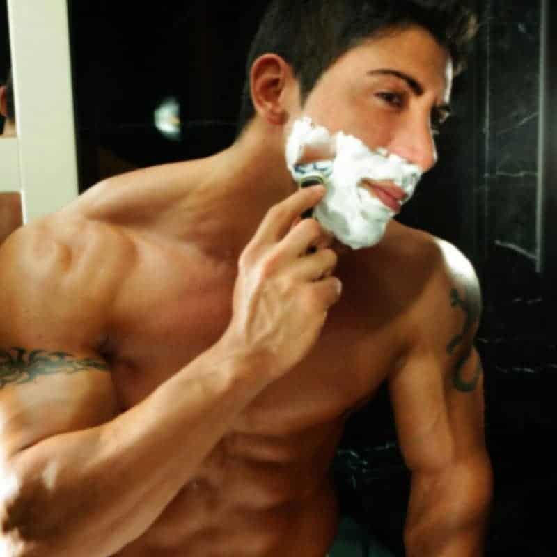 Boy strippers Barcelona in the mirror shaving his face
