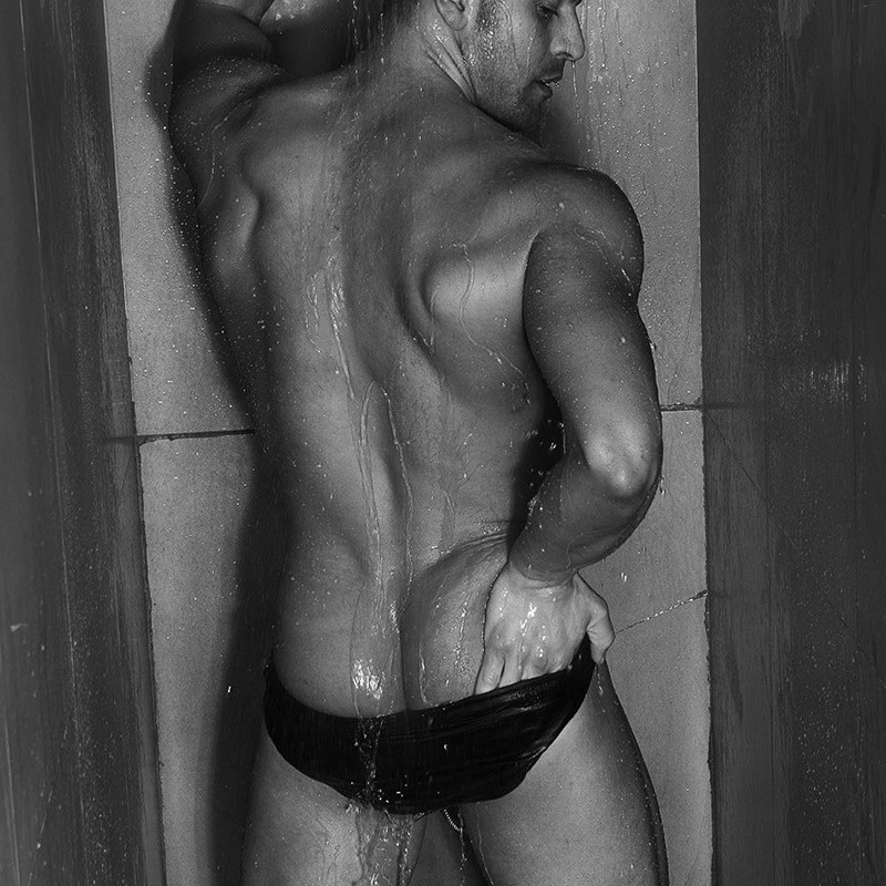 Barcelona strippers Joel Acosta in the shower show off half butt