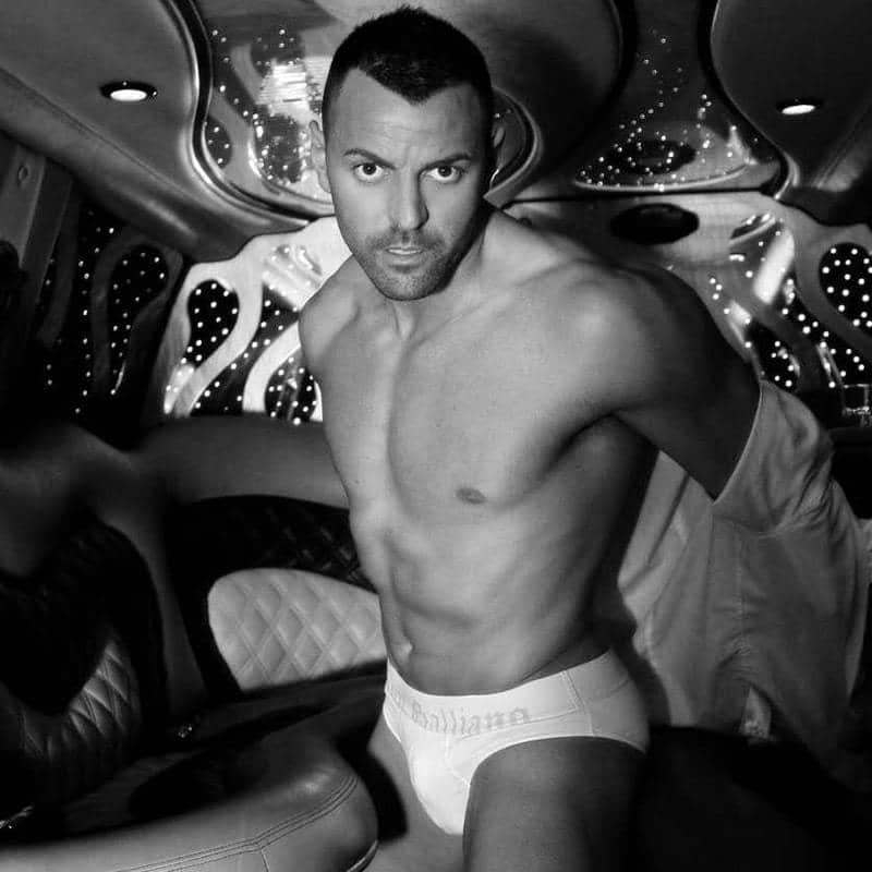Joel Acosta male strippers Barcelona in underwear in a limousine