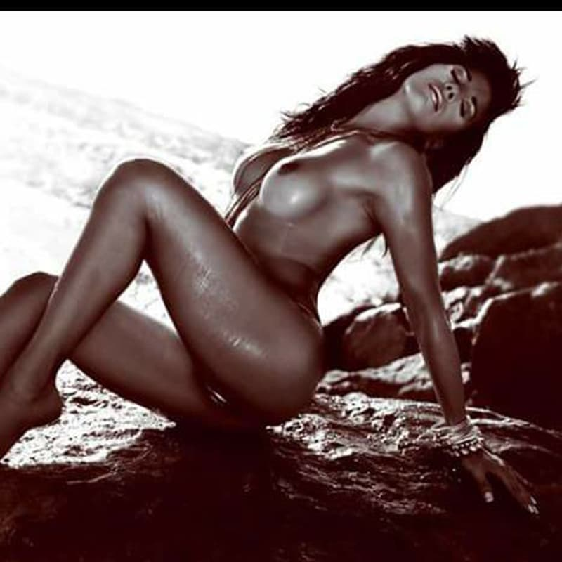 Vicky Barcelona stripper posing in a semi nude sensual position on a rock